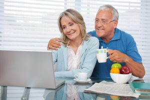 senior couple looking at laptop together